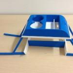 3D-печатная подставка для кофе и телефона в салоне Tesla Model S